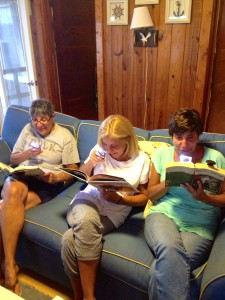My mom and twin aunts are reading at the beach!
